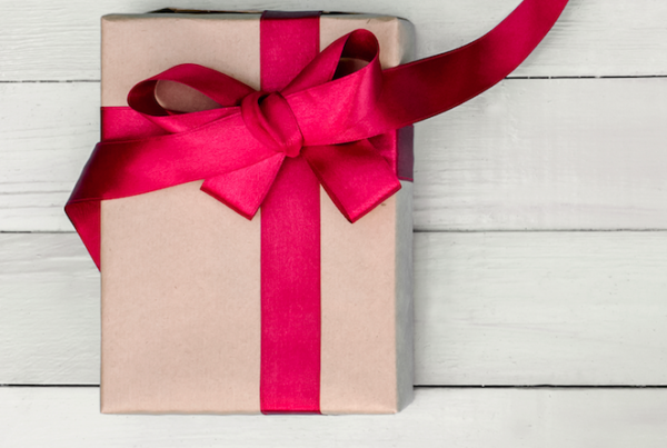 Present with Brown Paper and Red Bow