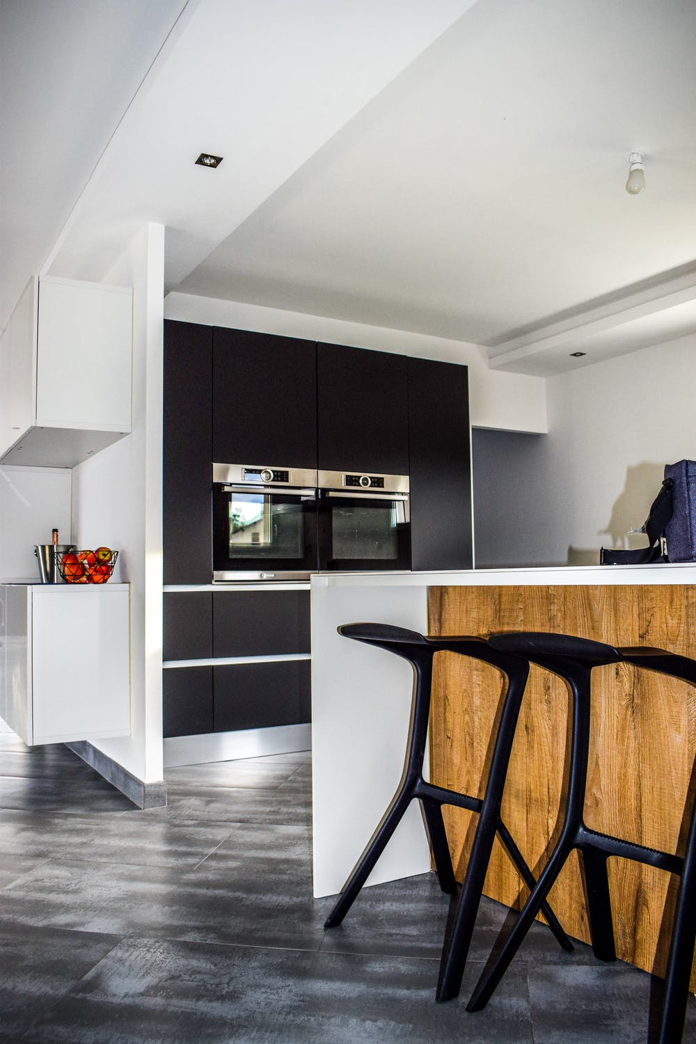 black kitchen cabinets and stools for interior design