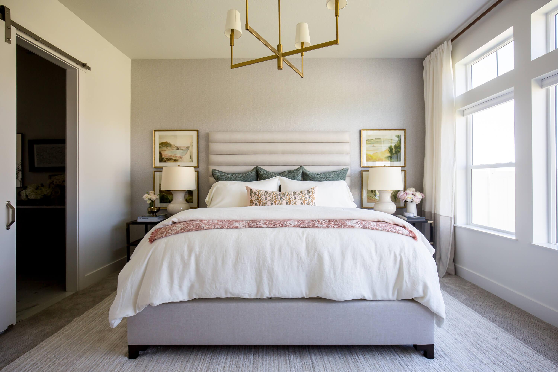 bedroom interior design with bedspread & luxury curtains