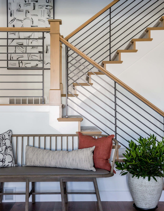 Modern Staircase Interior Design With Accent Chair, Pillows and Greenery