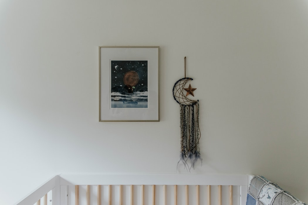 Nursery Decor With Crib and Woven Decoration