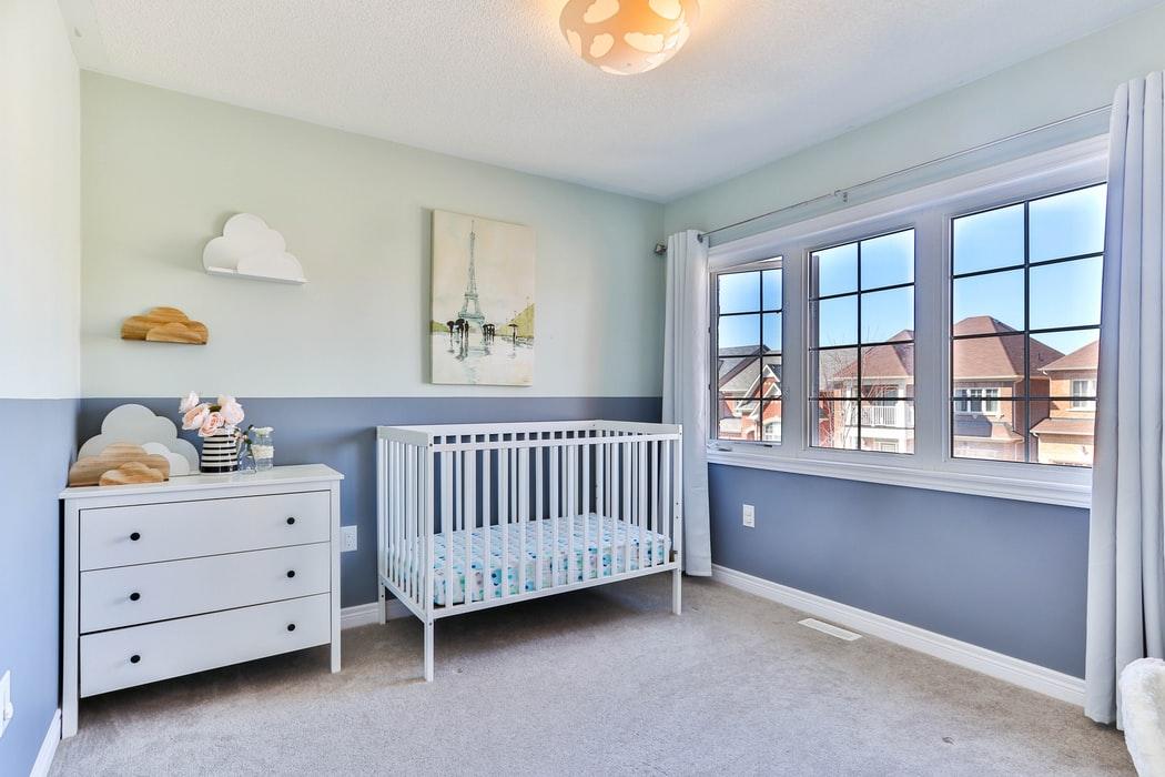 Nursery Design Theme With White Crib